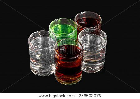 Multicolored Transparent Cocktails, A Set Of Shots In A Heap, A Wedge, Five Servings. Side View From