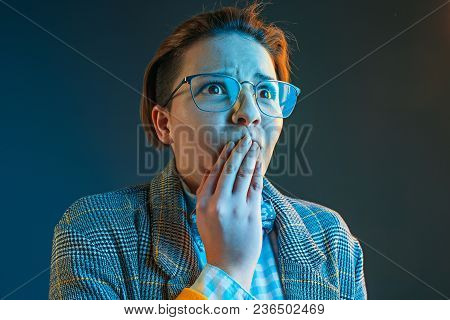 The Anger And Surprised Woman. Hate, Rage. Crying Emotional Angry Woman In Colorful Bright Lights At