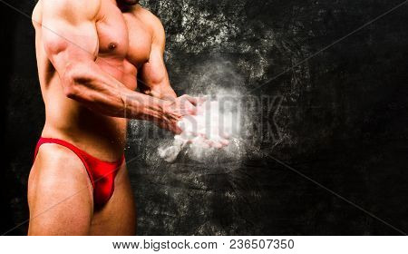 Bodybuilder Claps His Hands To Dust Of Magnesium Before The Show