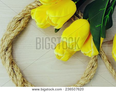 Yellow Tulip Artificial Flowers Bouquet On Wooden Background