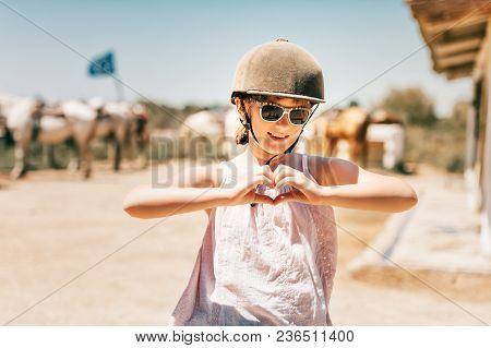 Happy Little Girl Enjoying Summer Vacation In Camargue, France. Child Visiting Horse Ranch