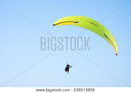 Tandem Paragliding Above Mediterranean Sea On Blue Sky Background