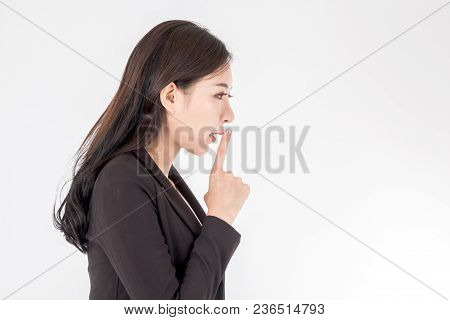 Business Woman Quiet Gesture With Finger On White Background