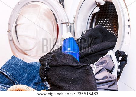 Dirty Cloth In Basket With Washing Machine