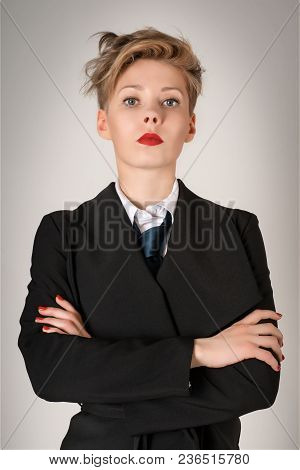 Serious Business Woman In Black Suit
