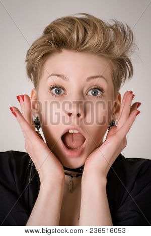 Amazed, Shocked Or Surprised Blond Woman