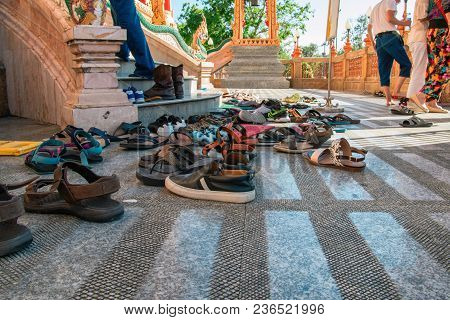 Shoes Left At The Entrance To The Buddhist Temple. Concept Of Observing Traditions, Tolerance, Grati