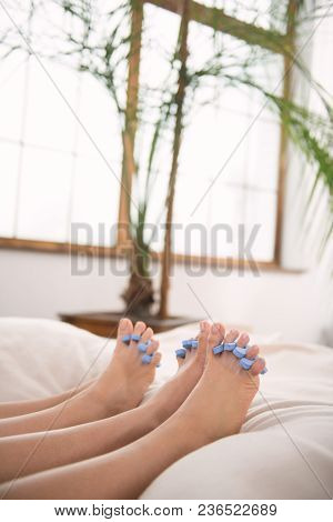 Perfect Pedicure. Close Up Of Female Feet With Toe Separators Put On Them