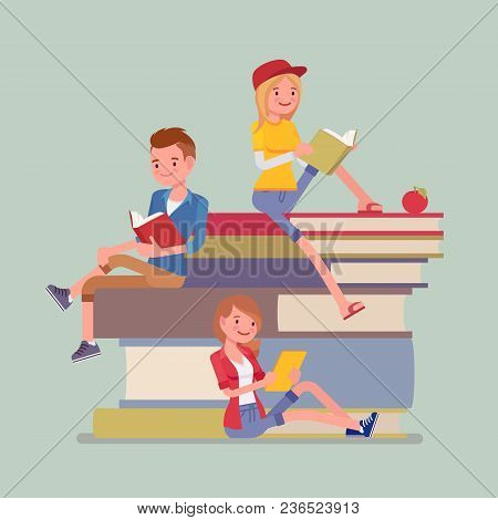 Students On Book Pile. Group Of Happy Young People Enjoy Reading, Devoted To Study, Sitting On Giant