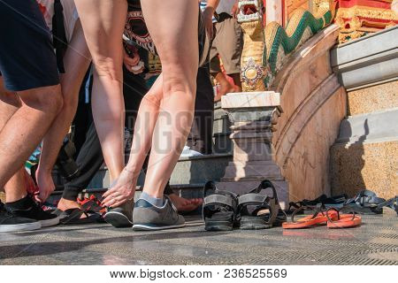 People Take Off Their Shoes Before Entering The Buddhist Temple. Concept Of Observing Traditions, To