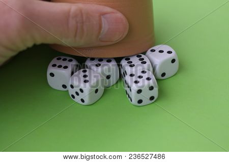 Dice Game With Dice Cup On Green Table Casino Concept