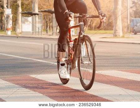 Cycling. The Cyclist Rides In The City At High Speed. Participation In The Bike Ride