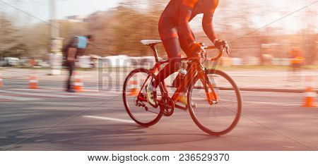 Cycling. The Cyclist Rides In The City At High Speed. Participation In The Bike Ride. Biker Ride On