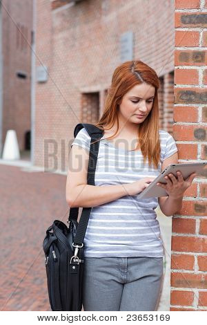 Portrait Of A Student Working With A Tablet Computer