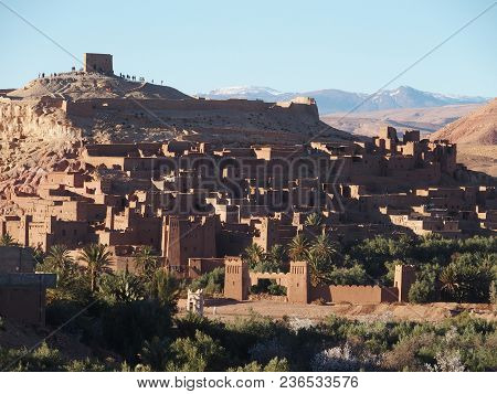 Kasbah Ait Ben Haddou Or Benhaddou Fortified City, Green Exotic Palm Trees At Oasis On African Atlas