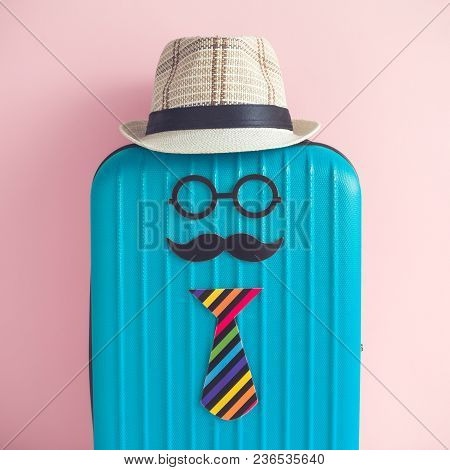 Suitcase And Paper Props In Form Of Globetrotter Hipster Person With Hat On Pastel Pink Background C