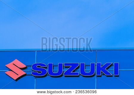 Vilnius, Lithuania- April 12, 2018: Suzuki Dealership Sign On The Wall. Suzuki Is A Japanese Multina