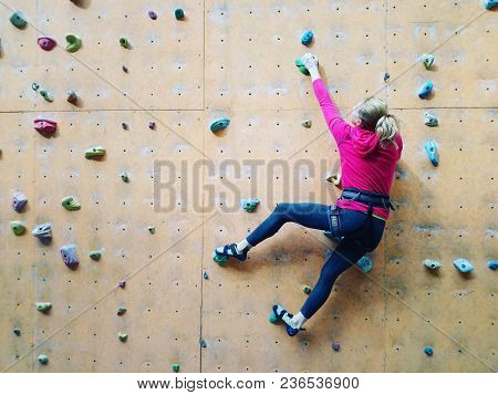 Fitness, Extreme Sport, Bouldering, People And Healthy Lifestyle Concept - Young Girl Exercising At