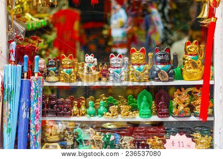 Maneki-neko (beckoning Cat), Japanese Figurines On Display In A Souvenir Shop In London Chinatown