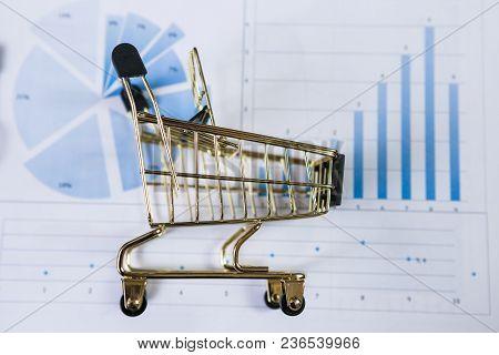 Shopping Cart On A Financial Report. Online Shopping.