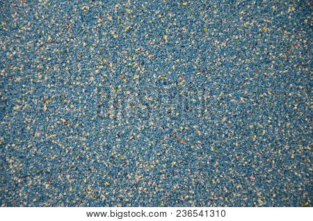 Texture Of A Colored Granular Sand Close Up. Blue Grains