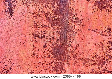 Old Rusty Metal Sheet Colored Red Paint Cracked. Abstract Background. Metallic Background.