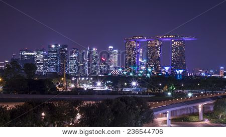 Marina Bay Sand Tower, Singapore - April 5, 2018 : Cityscape Night Light View Of Singapore Skyline A