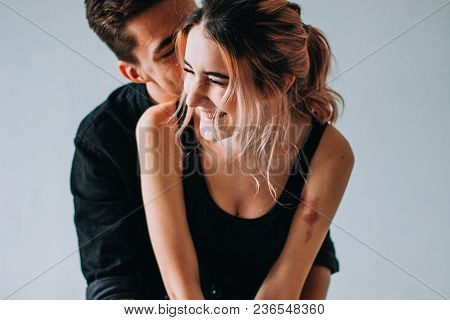 Young Couple In Love Have Fun I On New Years Eve Or St Valentines Day. Indoor