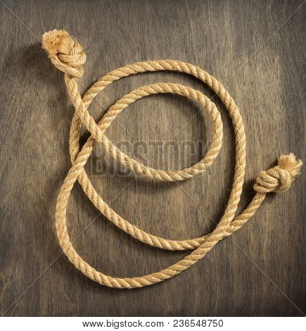 ship rope on aged wooden background