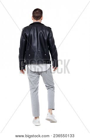 Back view of going  handsome man in a leather jacket and trousers. walking young guy . Rear view people collection.    Isolated over white background. Stylish guy in the suit goes into the distance