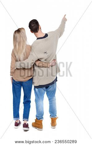 Back  view of a heterosexual couple who hugs and points out. Rear view people collection.  backside view of person.  Isolated over white background. A man and a woman are watching together