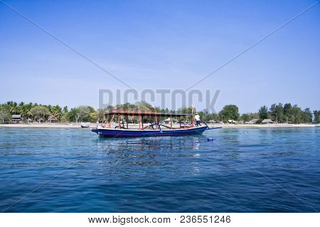 Outrigger Dive Boat Over Dive Site Off The Coast Of Gili Air Indoensia