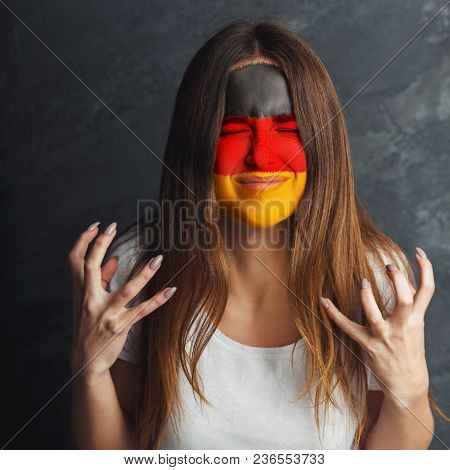 Portrait Of Sad Woman With The Flag Of Argentina Painted On Her Face. Football Or Soccer Team Fan, S