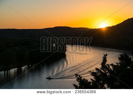 Austin Texas Sunset Silhouette Landscape At Town Lake Texas Hill Country With Colorado River A Boat