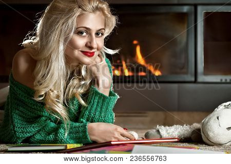 The Girl Reads A Book At Home