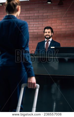 Cropped Shot Of Businesswoman With Luggage Going At Hotel Reception Counter