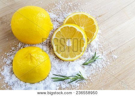 Lemon And Sea Salt - Beauty Treatment With Organic Cosmetics With Lemon Ingredients On Wood And Rose