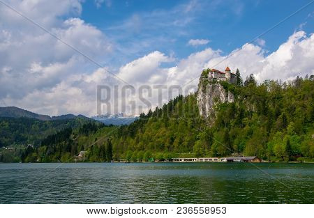 Scenic View Of Lake Bled - Popular Tourist Attraction In Julian Alps - With Castle On The Rock And M