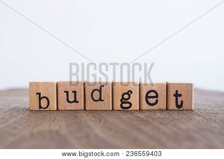 The Word Budget, Text On Wooden Cubes On Table Top. Background Copy Space, Minimal Style. Concepts F