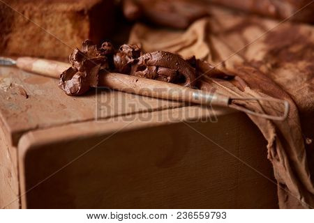 Conceptual Still Life With Art And Sculpture Tool In The Potter Workroom, Close-up, Shallow Depth Of