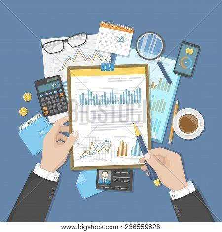 Businessman Analyzes Documents On Clipboard. Auditing, Accounting, Analysis, Analytics. Hands, Calcu