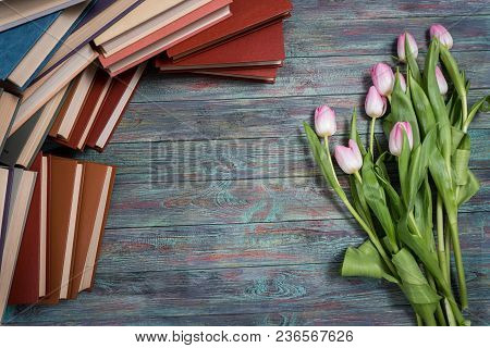 Pink Tulips With Books On Wooden Background With Copy Space