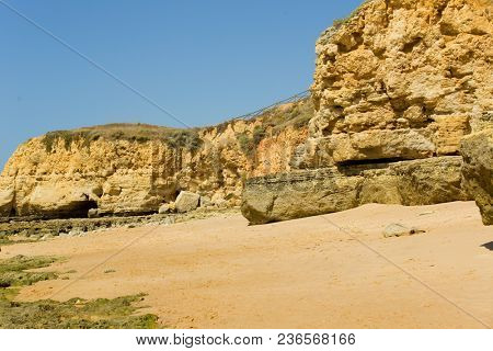 the famous beach of Olhos de Agua in Albufeira. This beach is a part of famous tourist region of Algarve. poster