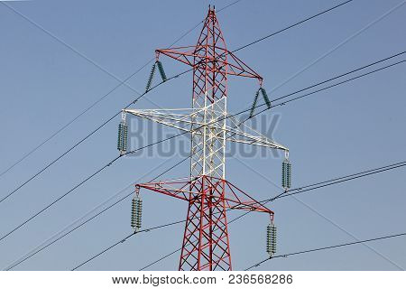 Electricity Post Energy Tower On Blue Sky.