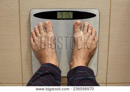 Man's Leg On A Scale.