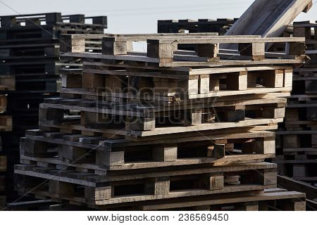 Stack Of Pallets Outdoors At Evening Light.