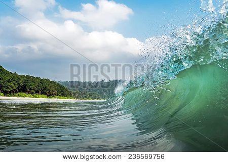 A Big Wave Covers. Radhanagar Beach At Andaman And Nicobar Island, India. View From The Sea. Bursts