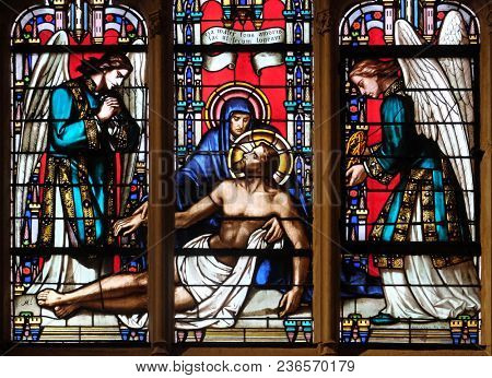 PARIS, FRANCE - JANUARY 09: Deposition from the Cross, stained glass window from Saint Germain-l'Auxerrois church in Paris, France on January 09, 2018.