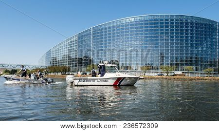 Strasbourg, France - Apr 17, 2018: National Gendarmerie Boat Near European Parliament Facade During