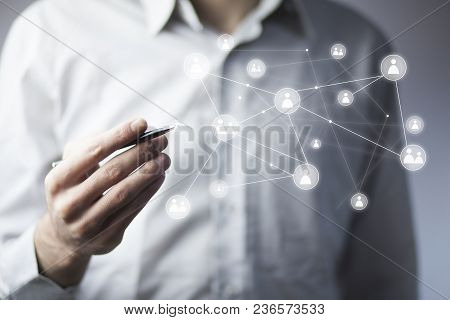 Businessman Hand Pen And  Virtual Social Media Buttons